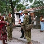Australian members of International Forces East Timor (INTERFET), talk to a citizen in Dili, East Timor. (Photo by PH3 Dan Mennuto)